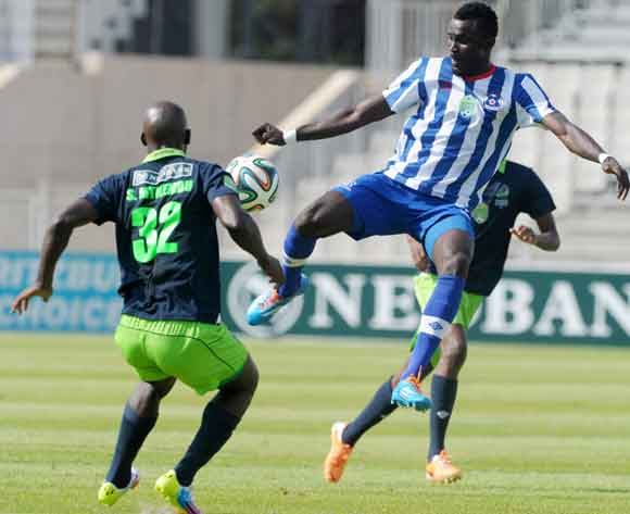 Mohammed Awal of Maritzburg United challenged by Siphelele Mthembu of Platinum Stars during the 2014 Nedbank Cup match between Platinum Stars and Maritzburg United at Moruleng Stadium in Rustenburg on the 22 March 2014 ©Muzi Ntombela/BackpagePix