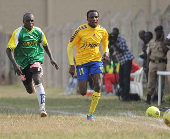 Collins Malele (L) of CRO FC challenges Michael Birungi of KCCA FC during the 2014 Fufa Super League at the Lugogo Stadium, Kampala on 18 February 2014 ©Ismail Kezaala/BackpagePix