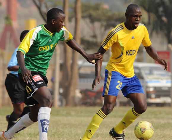 Jackson Busingye (L) and Collins Malele of CRO FC challenges Habib Kavuma of KCCA FC during the 2014 Fufa Super League at the Lugogo Stadium, Kampala on 18 February 2014 ©Ismail Kezaala/BackpagePix