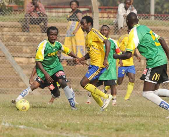 Ibrahim Masa (L) and Moses Munyesi of CRO FC challenges William Wadri of KCCA FC during the 2014 Fufa Super League at the Lugogo Stadium, Kampala on 18 February 2014 ©Ismail Kezaala/BackpagePix