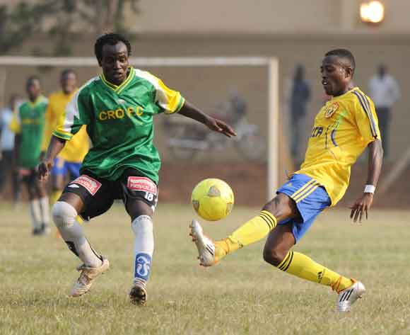 Ibrahim Masa (L) of CRO challenges Brian Majwega of KCCA FC during the 2014 Fufa Super League at the Lugogo Stadium, Kampala on 18 February 2014 ©Ismail Kezaala/BackpagePix