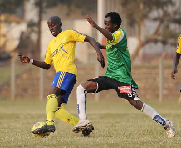 Ibrahim Masa of CRO FC challenges Rogers Aloro of KCCA FC during the 2014 Fufa Super League at the Lugogo Stadium, Kampala on 18 February 2014 ©Ismail Kezaala/BackpagePix