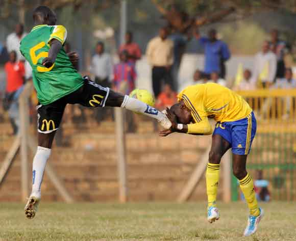 Moses Munyesi of CRO FC fouls Tonny Odur of KCCA FC as he attempts to head the ball during the 2014 Fufa Super League at the Lugogo Stadium, Kampala on 18 February 2014 ©Ismail Kezaala/BackpagePix