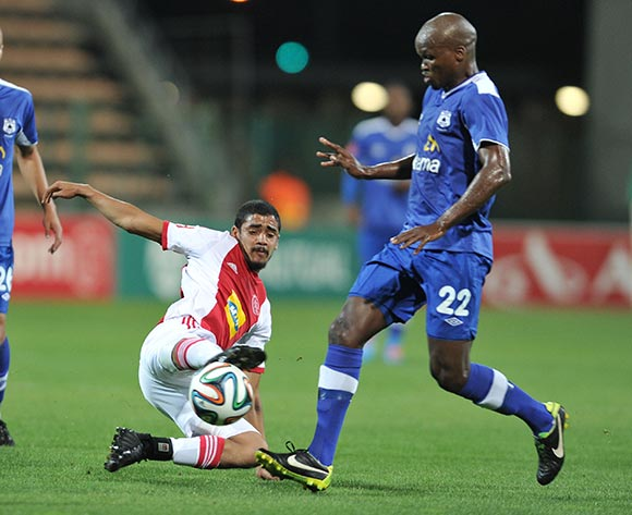 Abbubaker Mobara of Ajax Cape Town tackles Zamuxolo Ngalo of Black Aces during the Ajax Cape Town and Black Aces match at Athlone Stadium, Cape Town on 28 March 2014