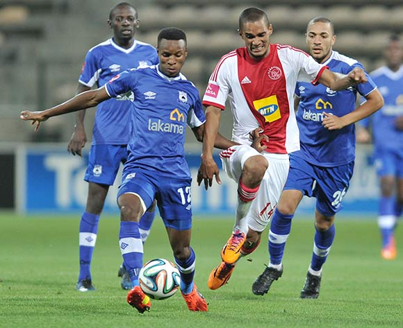 Themba Zwane of Black Aces and Tasriq Morris  of Ajax Cape Town during the Ajax Cape Town and Black Aces match at Athlone Stadium, Cape Town on 28 March 2014