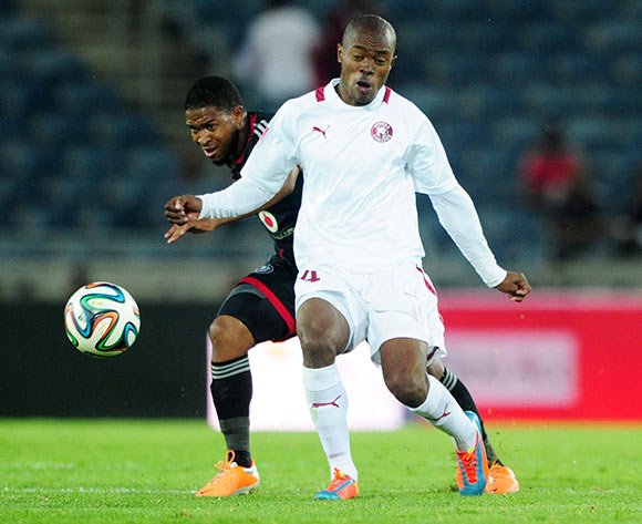 Asavela Mbekile of Moroka Swallows battles with Thandani Ntshumayelo of Orlando Pirates during the Absa Premiership 2013/14 match between Orlando Pirates and Moroka Swallows at Orlando Stadium in Soweto on the 29 March 2014
