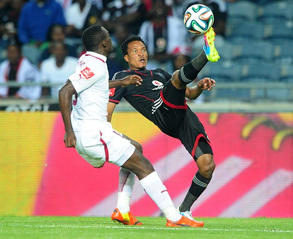 Tlou Segolela of Orlando Pirates  challenged by Gilbert Mapemba of Moroka Swallows during the Absa Premiership 2013/14 match between Orlando Pirates and Moroka Swallows at Orlando Stadium in Soweto on the 29 March 2014