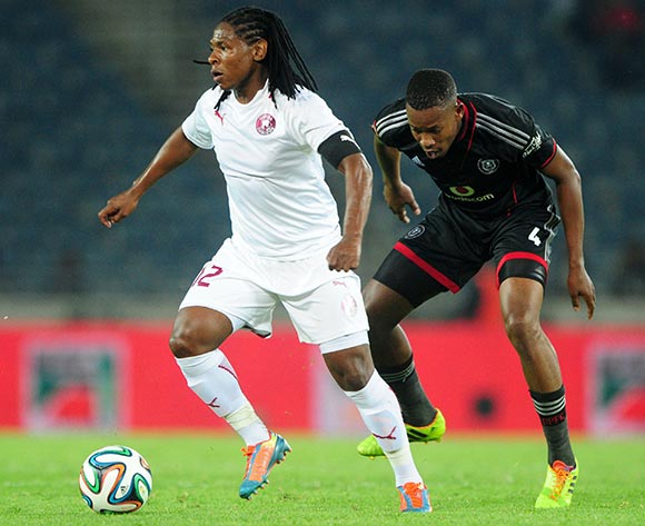 Lefa Tsutsulupa of Moroka Swallows challenged by Happy Jele of Orlando Pirates during the Absa Premiership 2013/14 match between Orlando Pirates and Moroka Swallows at Orlando Stadium in Soweto on the 29 March 2014