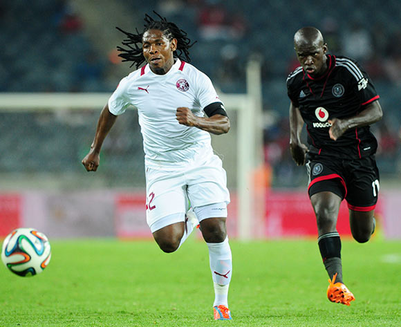 Lefa Tsutsulupa of Moroka Swallows challenged by Sifiso Myeni of Orlando Pirates during the Absa Premiership 2013/14 match between Orlando Pirates and Moroka Swallows at Orlando Stadium in Soweto on the 29 March 2014