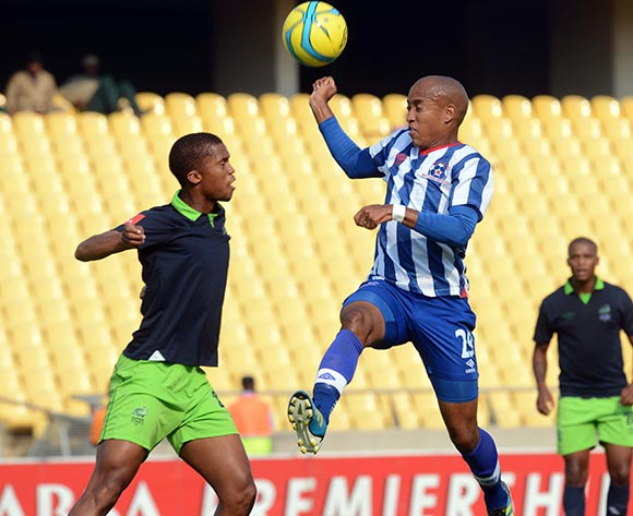 Tshepo Gumede of Platinum Stars battles with Kurt Lentjies  of Maritzburg United during the Absa Premiership match between Platinum Stars and Maritzburg United  on the 29 Royal Bafokeng Stadium