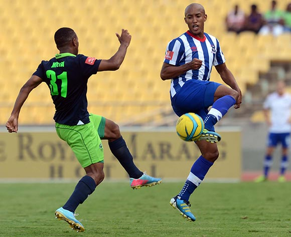 Luvolwethu Mpeta of Platinum Stars battles with Kurt Lentjies  of Maritzburg United during the Absa Premiership match between Platinum Stars and Maritzburg United  on the 29 Royal Bafokeng Stadium