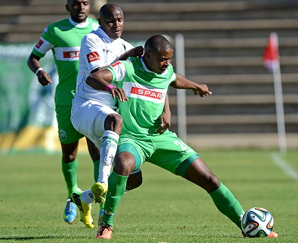 Joel Mogorosi of Bloemfontein Celtic FC and Tamsanqa Teyise of Amazulu FC during the Absa Premiership match between Bloemfontein Celtic FC and Amazulu FC at the Kaizer Sebothelo Stadium on 30 March 2014