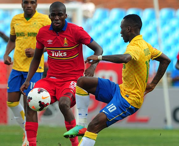 Mpho Matsi of University Pretoria challenged by Teko Modise of Mamelodi Sundowns during the Absa Premiership 2013/14 match between Mamelodi Sundowns and University of Pretoria at Loftus Stadium in Pretoria on the 30 March 2014