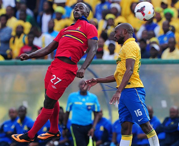 Ramahlwe Mphahlele of Mamelodi Sundowns battles with Atusaye Nyondo of University of Pretoria during the Absa Premiership 2013/14 match between Mamelodi Sundowns and University of Pretoria at Loftus Stadium in Pretoria on the 30 March 2014