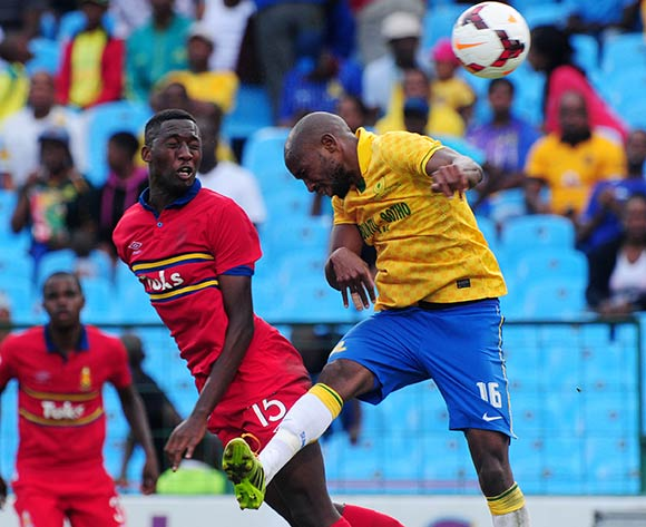 Ramahlwe Mphahlele of Mamelodi Sundowns battles with Buhle Mkhwanazi of University Pretoria during the Absa Premiership 2013/14 match between Mamelodi Sundowns and University of Pretoria at Loftus Stadium in Pretoria on the 30 March 2014