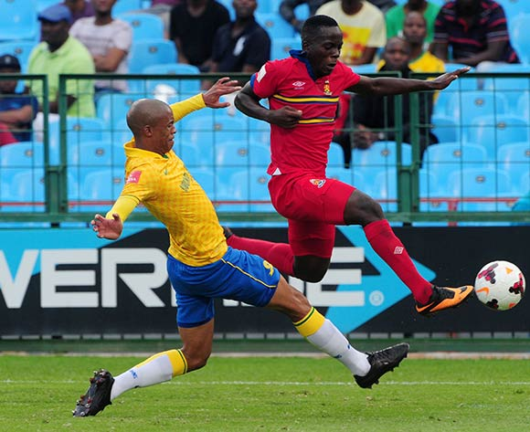 Atusaye Nyondo of University of Pretoria tackled by Thabo Nthethe of Mamelodi Sundowns during the Absa Premiership 2013/14 match between Mamelodi Sundowns and University of Pretoria at Loftus Stadium in Pretoria on the 30 March 2014