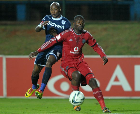 Rooi Mahamutsa of Orlando Pirates  challenged by Calvin Kadi of Bidvest Wits during the Absa Premiership 2013/14 match between Free State Stars and Black Aces at Bidvest Stadium in Johannesburg on the 30 April 2014