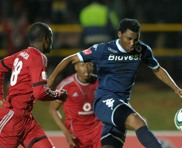 Sthembiso Ngcobo of Bidvest Wits challenged by Rooi Mahamutsa of Orlando Pirates  during the Absa Premiership 2013/14 match between Free State Stars and Black Aces at Bidvest Stadium in Johannesburg on the 30 April 2014