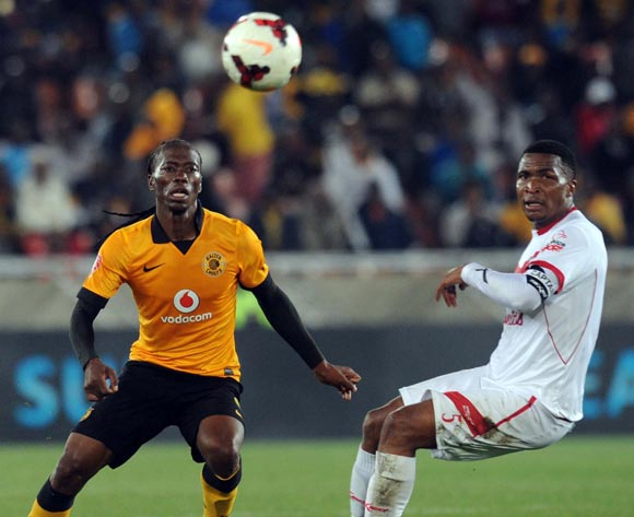 Reneilwe Letsholonyane of Kaizer Chiefs battles with Paulus Masehe of Free State Stars during the Absa Premiership match between Kaizer Chiefs and Free State Stars   on the 30 of April 2014 at Peter Mokaba Stadium