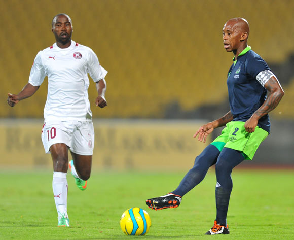 Vuyo Mere of Platinum Stars challenged by Siyabonga Nomvethe of Moroka Swallows during the Absa Premiership football match between Platinum Stars and Moroka Swallows at the Royal Bafokeng Stadium, Rustenburg on o1 April 2014