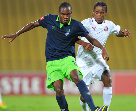 Mogakolodi Ngele of Platinum Stars challenged by Levy Mokgothu of Moroka Swallows during the Absa Premiership football match between Platinum Stars and Moroka Swallows at the Royal Bafokeng Stadium, Rustenburg on o1 April 2014