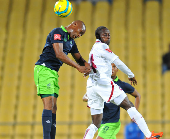 Gift Sithole 0f Platinum Stars challenged by Nyanda Mduduzi of Platinum Stars during the Absa Premiership football match between Platinum Stars and Moroka Swallows at the Royal Bafokeng Stadium, Rustenburg on o1 April 2014