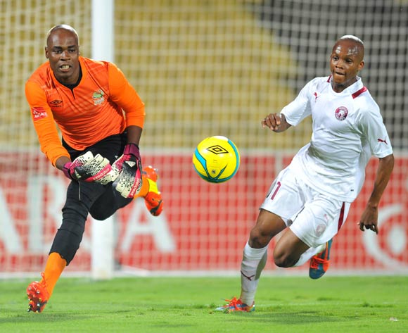 Siyabonga Mpontshane of Platinum Stars challenged by Dikgang Mabalane of Moroka Swallows during the Absa Premiership football match between Platinum Stars and Moroka Swallows at the Royal Bafokeng Stadium, Rustenburg on o1 April 2014
