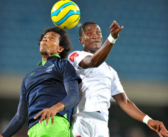 Issa Sarr of Platinum Stars challenged by Tshwarelo Bereng of Moroka Swallows during the Absa Premiership football match between Platinum Stars and Moroka Swallows at the Royal Bafokeng Stadium, Rustenburg on o1 April 2014