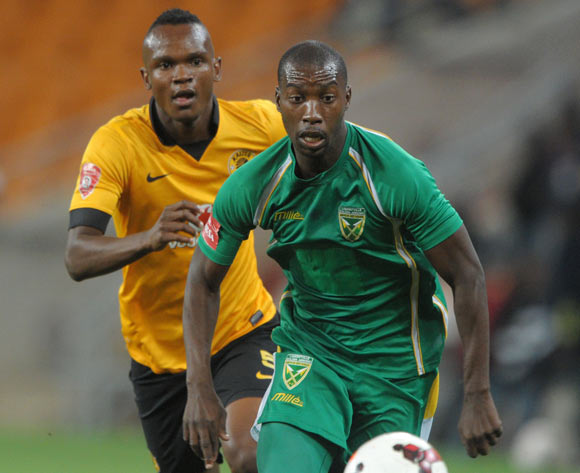 Nkanyiso Mlotshwa of Golden Arrows challenged by Siboniso Gaxa of Kaizer Chiefs  during the Absa Premiership 2013/14 match between Kaizer Chiefs and Golden Arrows at FNB Stadium in Johannesburg on the 02 April 2014