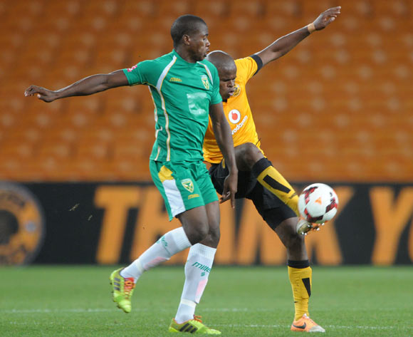 Willard Katsande of Kaizer Chiefs battles with Bongi Ntuli of Golden Arrows during the Absa Premiership 2013/14 match between Kaizer Chiefs and Golden Arrows at FNB Stadium in Johannesburg on the 02 April 2014