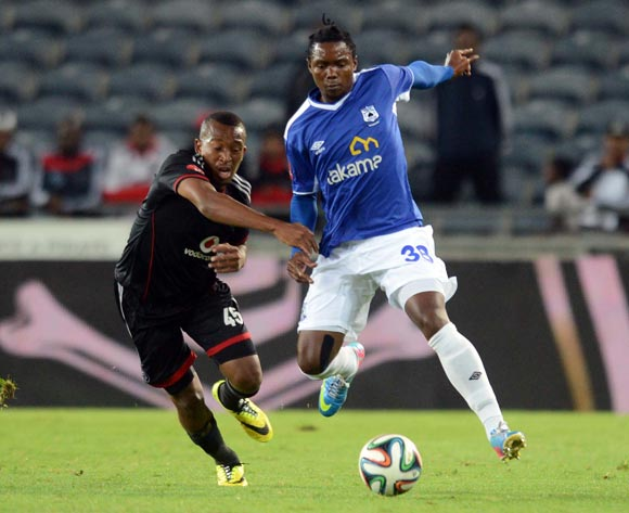 Lehlohonolo Majoro of Orlando Pirates battles with Mbulelo Mabizela of Black Aces during the Absa Premiership match between Orlando Pirates and MP Black Aces  on the 02 of April 2014 at Orlando Stadium