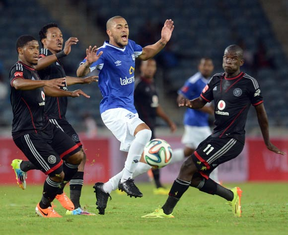 Thandani Ntshumayelo, Tlou Segolela and Sifiso Myeni of Orlando Pirates battle with Miguel Timm of Black Aces during the Absa Premiership match between Orlando Pirates and MP Black Aces  on the 02 of April 2014 at Orlando Stadium