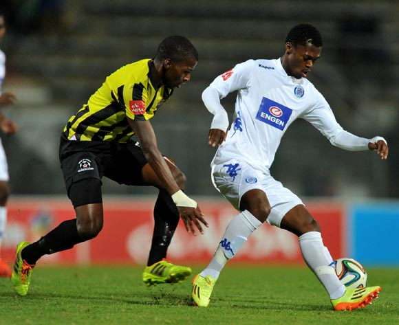 Thato Mokeke of Supersport United challenged by Thamsanqa Mkhize of Maritzburg United during the Absa Premiership football match between Supersport United v Maritzburg United at the Lucas Moripe Stadium, Pretoriag on o1 April 2014