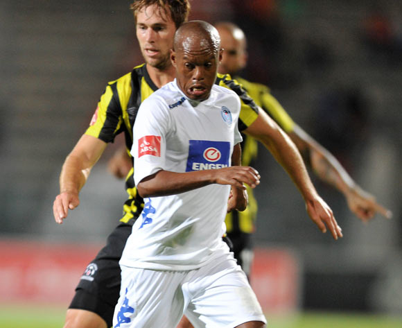 Jabu Mahlangu of Supersport United challenged by Rheece Evans of Maritzburg United during the Absa Premiership football match between Supersport United v Maritzburg United at the Lucas Moripe Stadium, Pretoriag on o1 April 2014