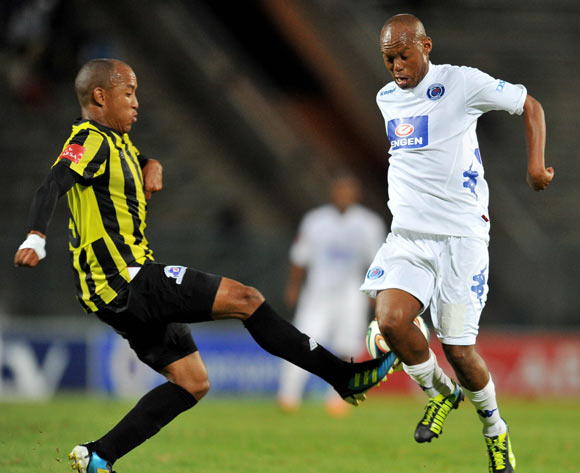 Jabu Mahlangu of Supersport United challenged by Kurt Lentjies of Maritzburg United during the Absa Premiership football match between Supersport United v Maritzburg United at the Lucas Moripe Stadium, Pretoriag on o1 April 2014
