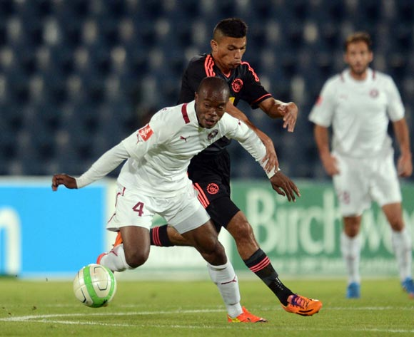 Asavela Mbekile of Moroka Swallows battles with Toriq Losper of Ajax Cape Town during the Absa Premiership match between Moroka Swallows and Ajax Cape Town on the 04 of April 2014 at Dobsonville Stadium