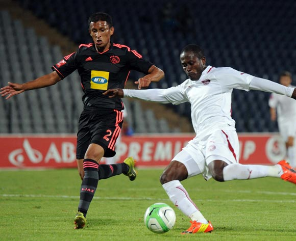 Felix Obada of Moroka Swallows battles with Nazeer Allie of Ajax Cape Town during the Absa Premiership match between Moroka Swallows and Ajax Cape Town on the 04 of April 2014 at Dobsonville Stadium