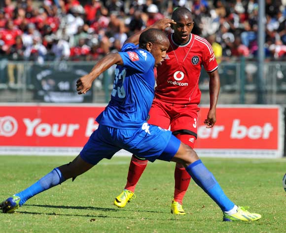 Patrick Phungwayo of Orlando Pirates challenged by Lebohang Manyama of Supersport United during the Absa Premiership football match between Supersport United and Orlando Pirates at the Lucas Moripe Stadium, Pretoria on o5 April 2014