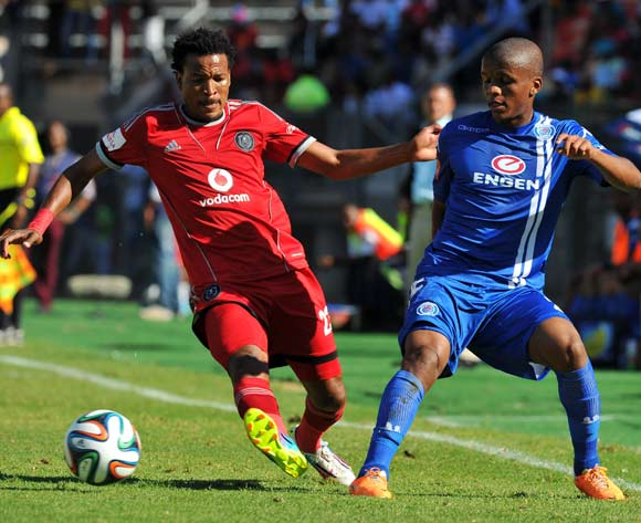 Thabo Moloi of Supersport United challenged by Tlou Segolela of Orlando Pirates during the Absa Premiership football match between Supersport United and Orlando Pirates at the Lucas Moripe Stadium, Pretoria on o5 April 2014