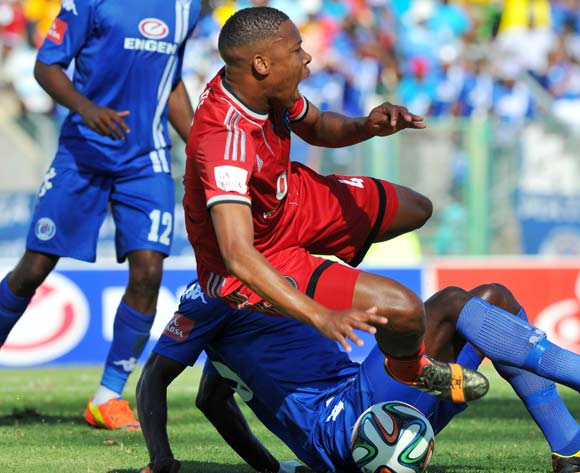 Happy Jele of Orlando Pirates tackled by Edwin Gyimah of Supersport United during the Absa Premiership football match between Supersport United and Orlando Pirates at the Lucas Moripe Stadium, Pretoria on o5 April 2014