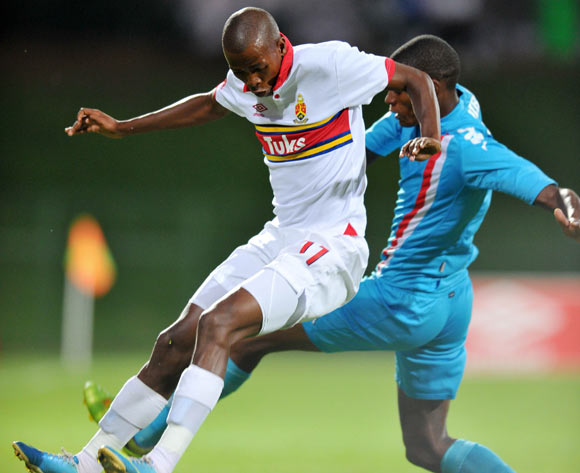 Thabo Mosadi of University Pretoria challenged by Vukile Mngqibisa of Polokwane City during the Absa Premiership football match between University of Pretoria and Polokwane City at the Tuks Stadium, Pretoria on o5 April 2014