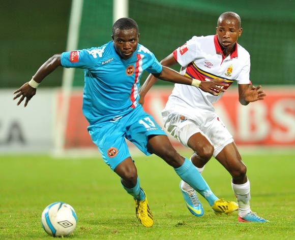 Moyana Galabgwe of Polokwane City challenged by Thabo Mosadi of University Pretoria during the Absa Premiership football match between University of Pretoria and Polokwane City at the Tuks Stadium, Pretoria on o5 April 2014