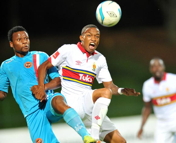 Grant Kekana of University Pretoria challenged by Thobani Mncwango of Polokwane City during the Absa Premiership football match between University of Pretoria and Polokwane City at the Tuks Stadium, Pretoria on o5 April 2014