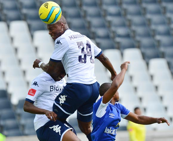 Letladi Madubanya of Bidvest Wits beats Thabo Qalinge of Black Aces in the air during the 2013/14 Absa Premiership football match between Black Aces and Bidvest Wits at Mbombela Stadium, Nelspruit  on 5 April 2014