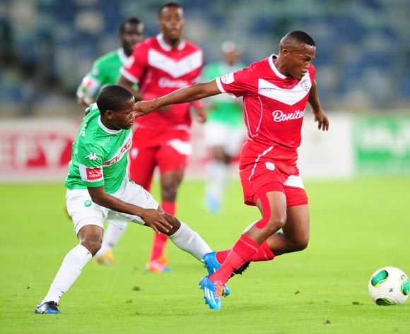 Angelo Kerspuy of Free State Stars battles Nkhosinathi Mthiyane of AmaZulu during the Absa Premiership 2013/14 football match between AmaZulu and Free State Stars at the Moses Mabhida Stadium in Durban , Kwa-Zulu Natal on the 5th of April 2014