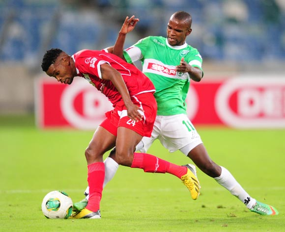 Bokang Tlhone of Free State Stars battles Ayanda Dlamini of AmaZulu during the Absa Premiership 2013/14 football match between AmaZulu and Free State Stars at the Moses Mabhida Stadium in Durban , Kwa-Zulu Natal on the 5th of April 2014
