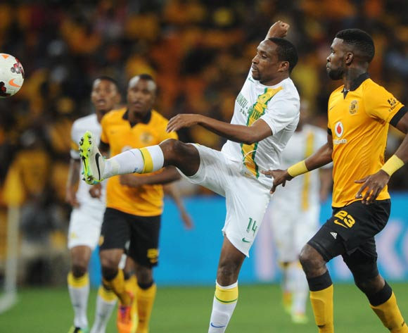 Surprise Moriri of Mamelodi Sundowns challenged by Tefu Mashamaite of Kaizer Chiefs during the Absa Premiership 2013/14 match between Kaizer Chiefs and Mamelodi Sundowns at FNB Stadium in Johannesburg on the 05 April 2014