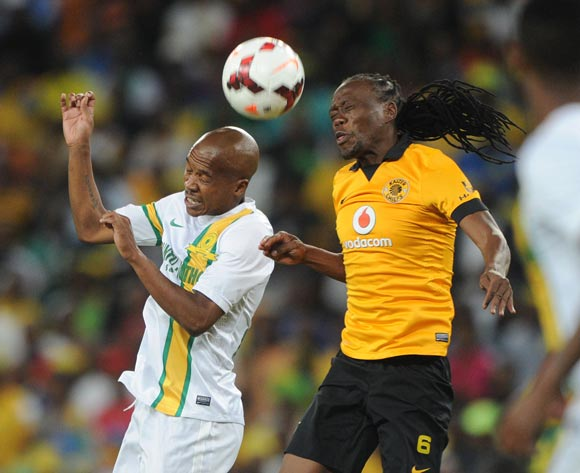 Lebohang Mokoena of Mamelodi Sundowns battles with Reneilwe Letsholonyane of Kaizer Chiefs during the Absa Premiership 2013/14 match between Kaizer Chiefs and Mamelodi Sundowns at FNB Stadium in Johannesburg on the 05 April 2014