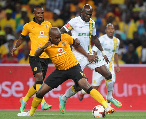 Morgan Gould of Kaizer Chiefs challenged by Anthony Laffor of Mamelodi Sundowns during the Absa Premiership 2013/14 match between Kaizer Chiefs and Mamelodi Sundowns at FNB Stadium in Johannesburg on the 05 April 2014
