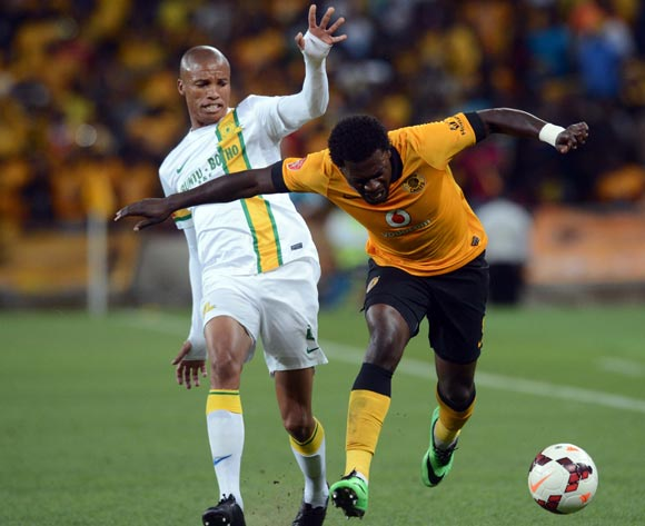 Thabo Nthethe of Mamelodi Sundowns battles with Kingston Nkhatha of Kaizer Chiefs during the Absa Premiership match between Kaizer Chiefs and Mamelodi Sundowns on the 05 of April 2014 at FNB Stadium